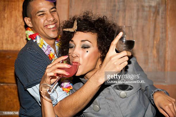 Friends drinking together at party