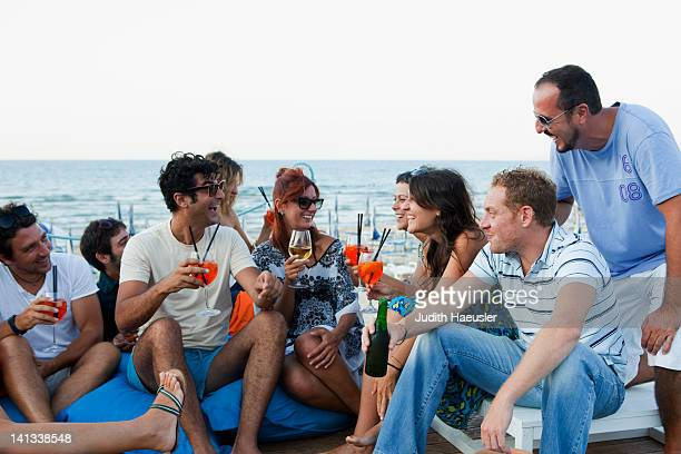 Friends drinking together outdoors