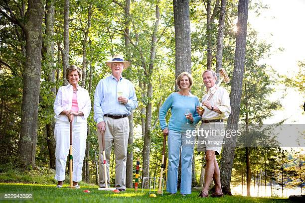 Friends Drinking Wine and Playing Croquet