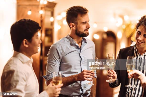 friends drinking wine at home - party social event stock pictures, royalty-free photos & images