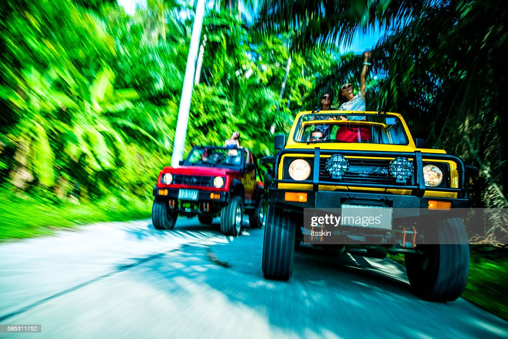 Friends driving 4x4 cars down the road : Stock Photo