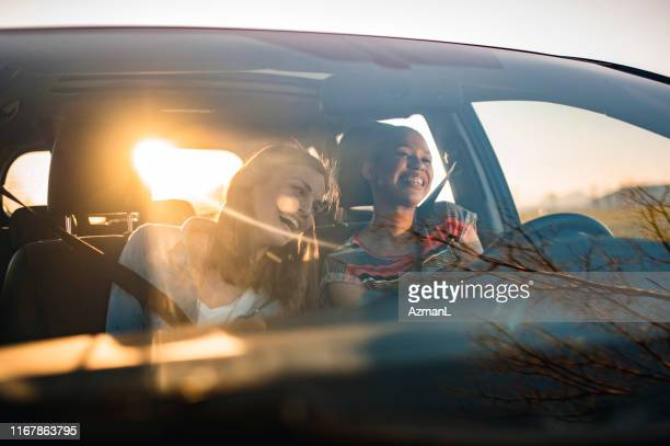 friends driving in a car on a sunny day - singing stock pictures, royalty-free photos & images