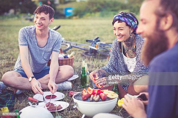 Friends eating and having fun on picnic