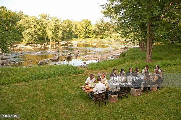 friends eating at an outdoor dinner party