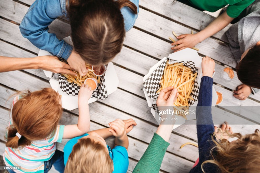 Friends Eating At Food Truck : Stock Photo