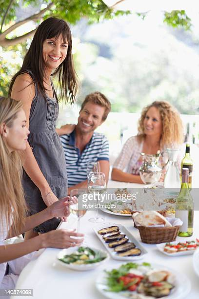 Friends eating at table outdoors