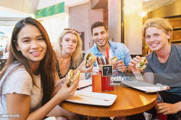 Friends eating Burgers and French Fries Sydney Australia