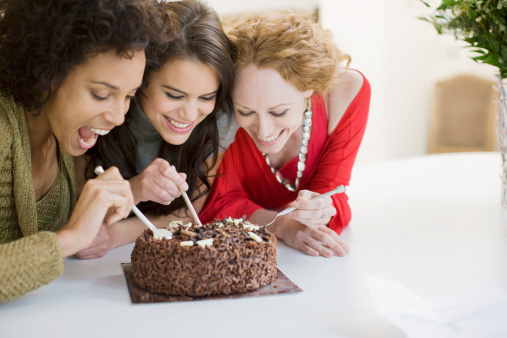 Friends eating chocolate cake - gettyimageskorea