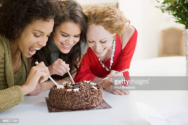 friends eating chocolate cake - indulgence stock pictures, royalty-free photos & images