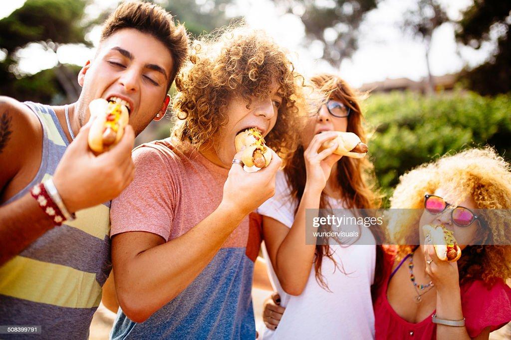 Friends Eating Hotdogs : Stock Photo