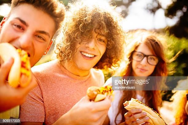 Friends Eating Hotdogs