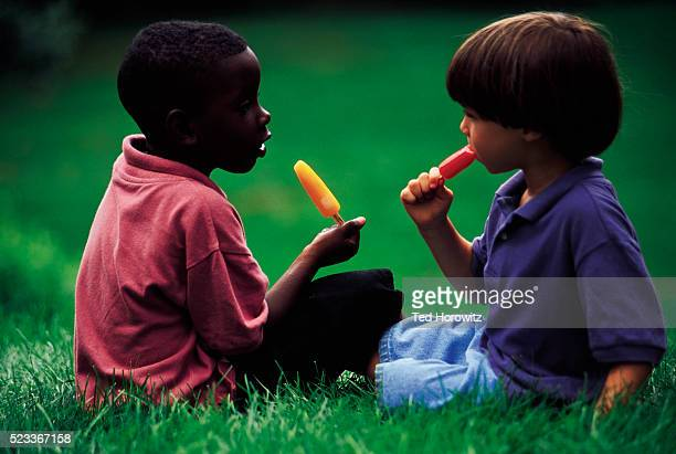 Friends eating Popsicles