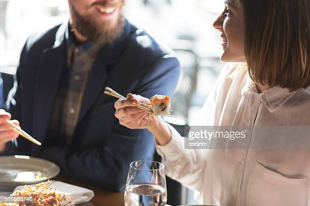 friends eating sushi - seafood stock pictures, royalty-free photos & images