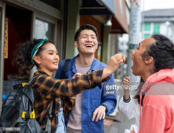friends eating take away chicken - chicken nugget stock pictures, royalty-free photos & images
