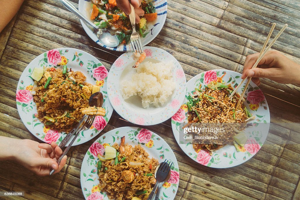 Friends eating Thai food : Stock Photo