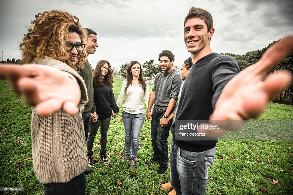 Friends embraced enjoy holding hands : Stock Photo