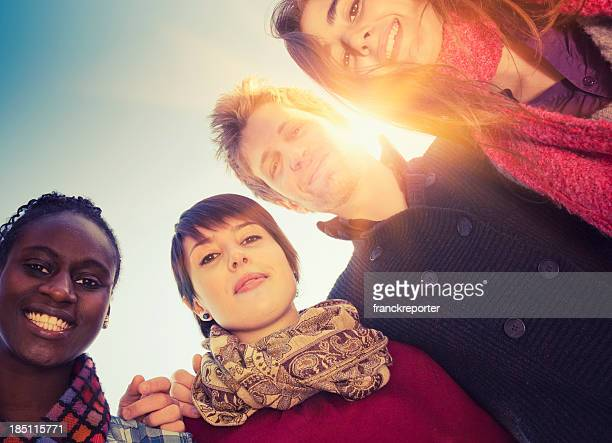 Friends embraced enjoy looking down at sunlight