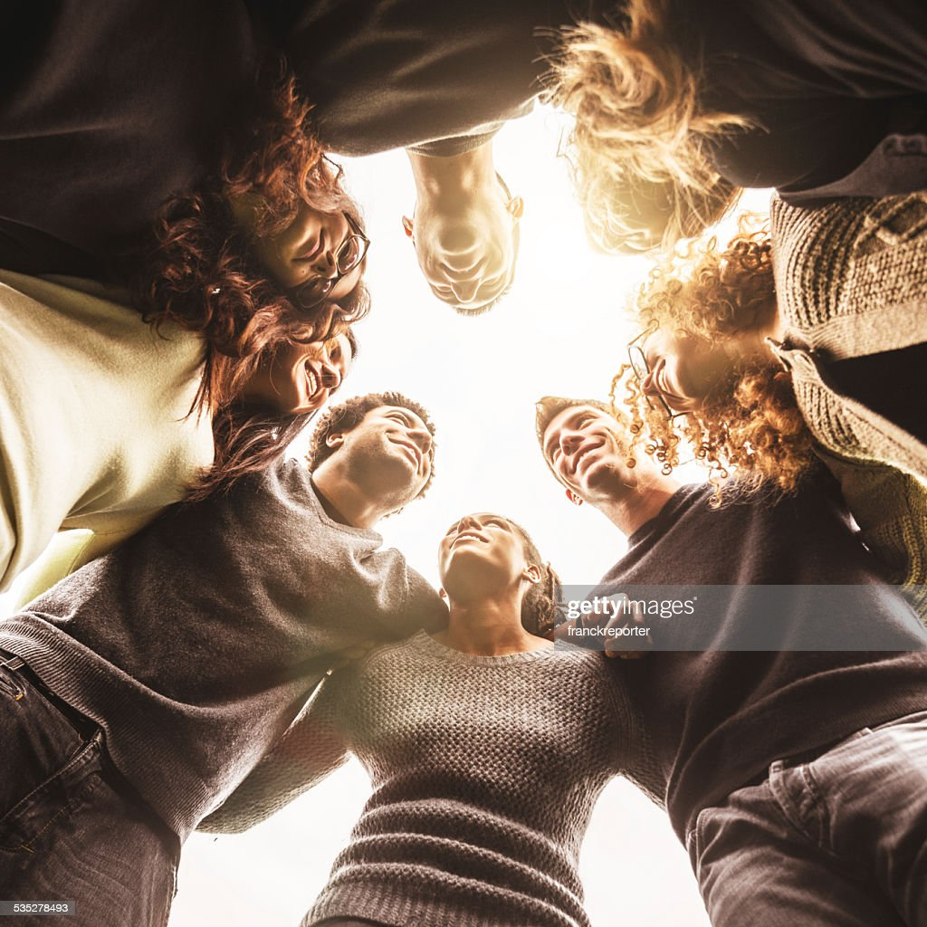 Friends embraced enjoy looking down : Stock Photo