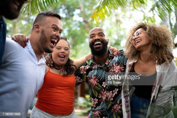 friends embracing and singing together during family reunion - intellectually disabled stock pictures, royalty-free photos & images