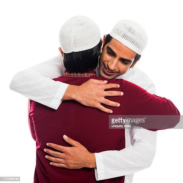 friends embracing each other during eid festival - aid el kebir photos et images de collection