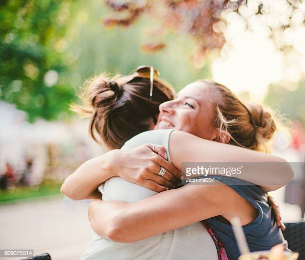 friends embracing - girlfriend stock photos and pictures