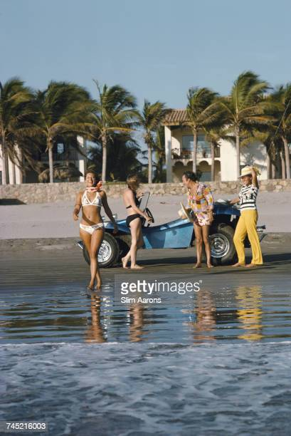 Friends enjoy a day out driving a beach buggy in Acapulco 1975