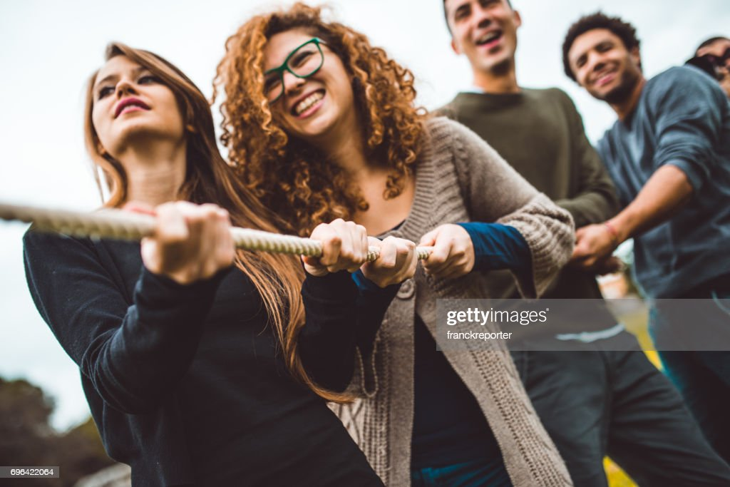 friends enjoy the tug of war game : Stock Photo