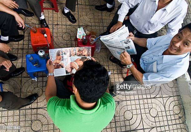 CONTENT] Friends enjoy their morning coffee with newspapers andmagazines Photo taken in Saigon / Ho Chi Minh city