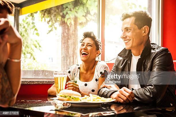 Friends enjoy together dinner in a cafe