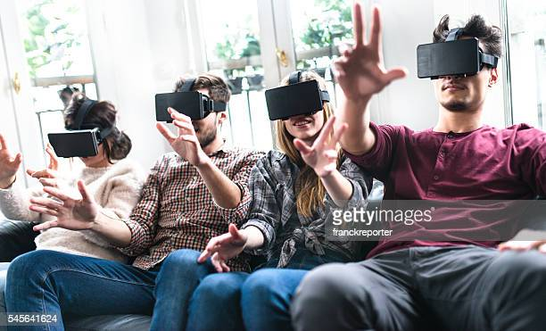 friends enjoy using the VR simulator togetherness