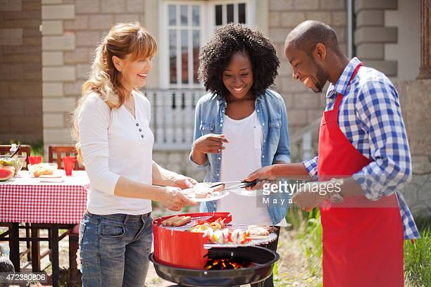 Friends enjoying a barbecue on a sunny day