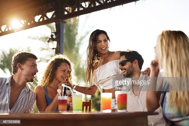 Friends enjoying a day in a bar and communicating.