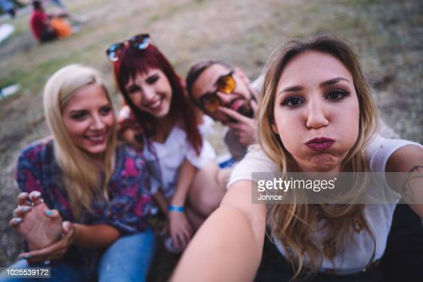 friends enjoying a day in the park - camera point of view stock photos and pictures