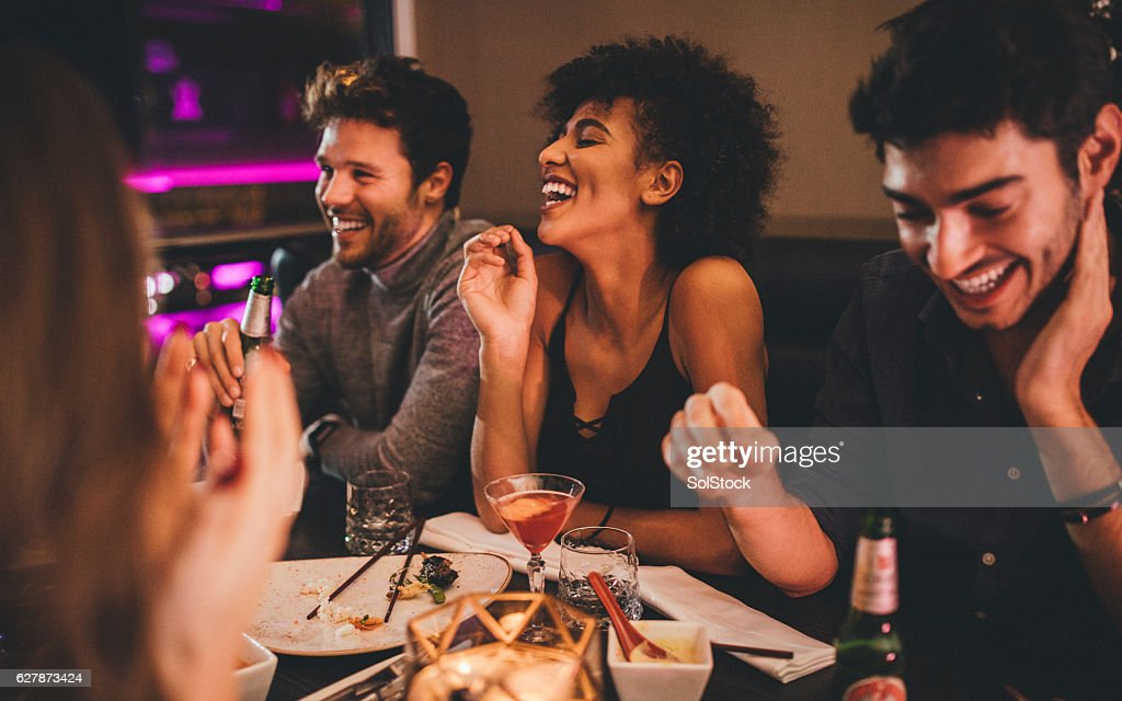 Friends Enjoying a Meal : Stock Photo