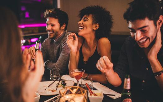 Friends Enjoying a Meal 627873424