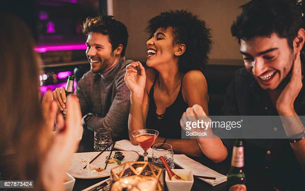friends enjoying a meal - evening meal stock pictures, royalty-free photos & images