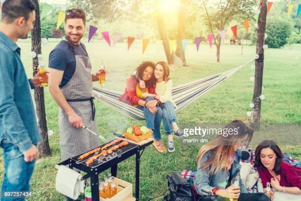 Friends enjoying a picnic among nature