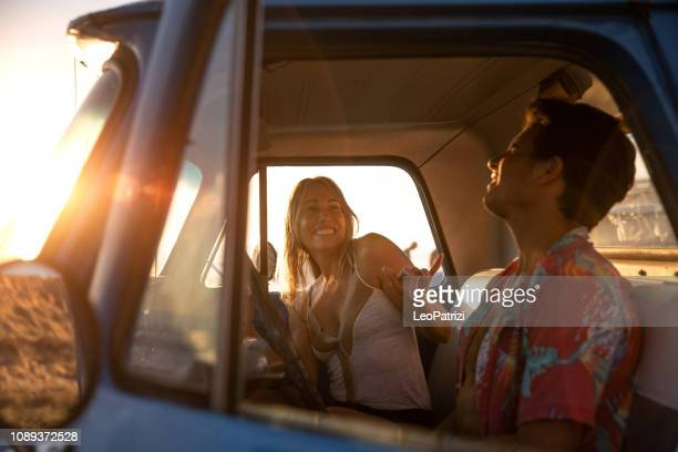 friends enjoying a road trip together in the wild california - singing stock pictures, royalty-free photos & images