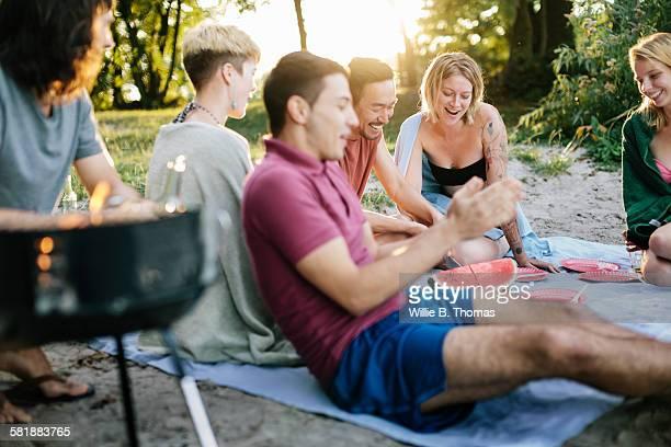 Friends enjoying an outdoor cookout