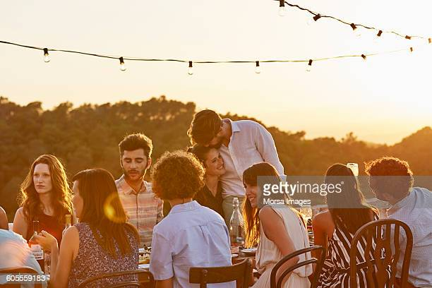 friends enjoying at dinner party - evening meal stock pictures, royalty-free photos & images