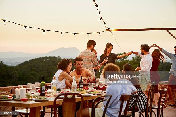 friends enjoying at patio during social gathering - catalonia stock pictures, royalty-free photos & images