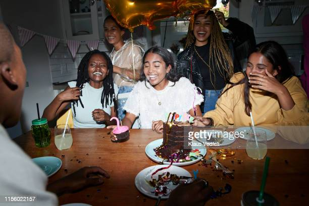 friends enjoying birthday at home - 21st birthday stock pictures, royalty-free photos & images