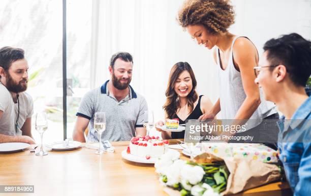Friends enjoying birthday celebration of their colleague.