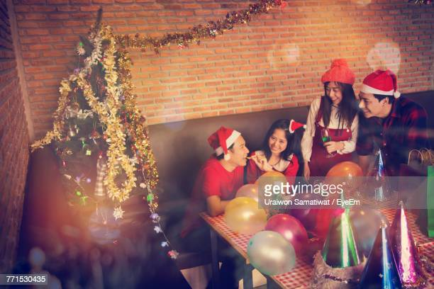 Friends Enjoying Christmas Party At Home