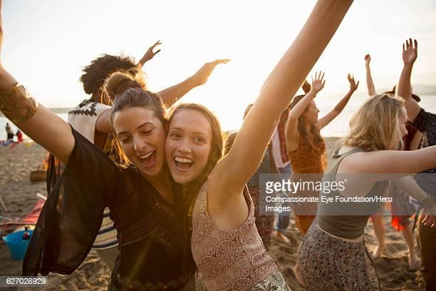 Friends enjoying dancing on beach
