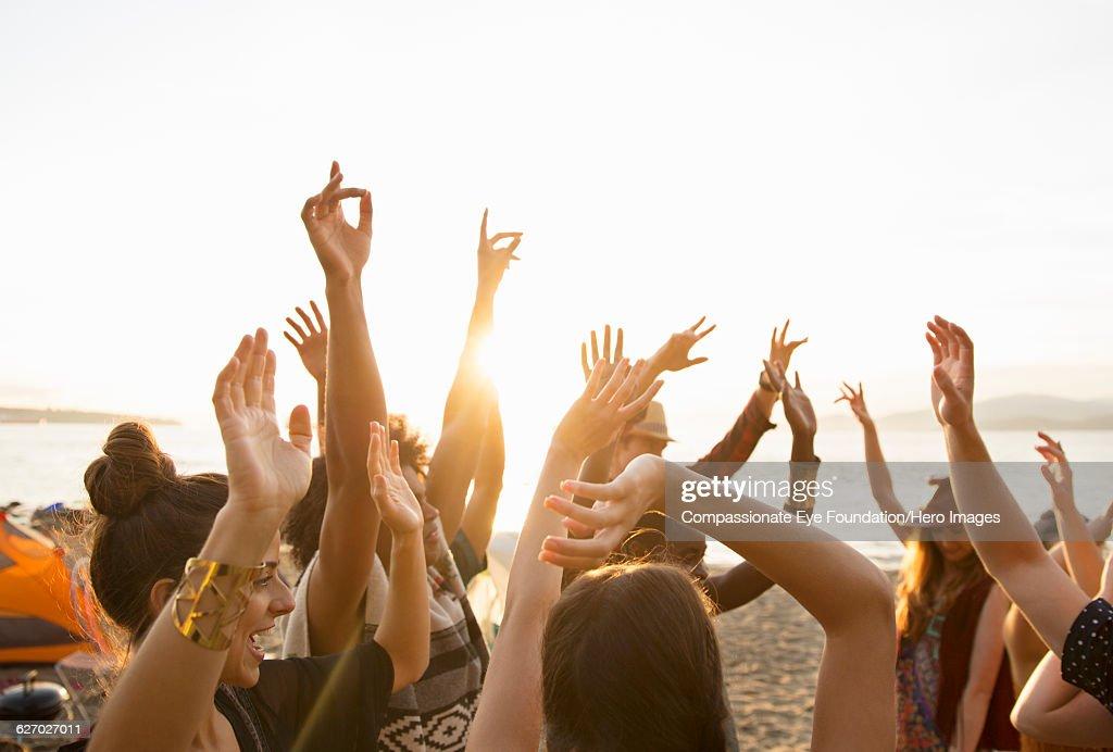 Friends enjoying dancing on beach : Stock Photo
