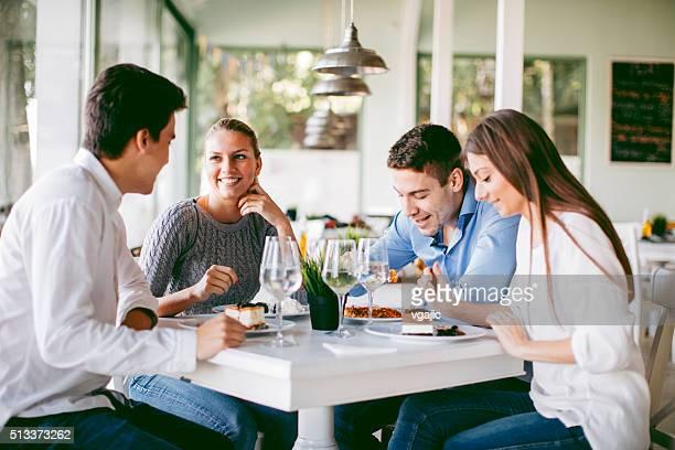 Friends Enjoying Dessert In Restaurant.