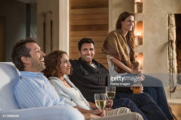 Friends enjoying drinks, friendship and stories.