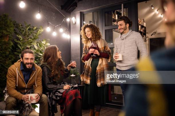 friends enjoying drinks in party at backyard - four people stock pictures, royalty-free photos & images