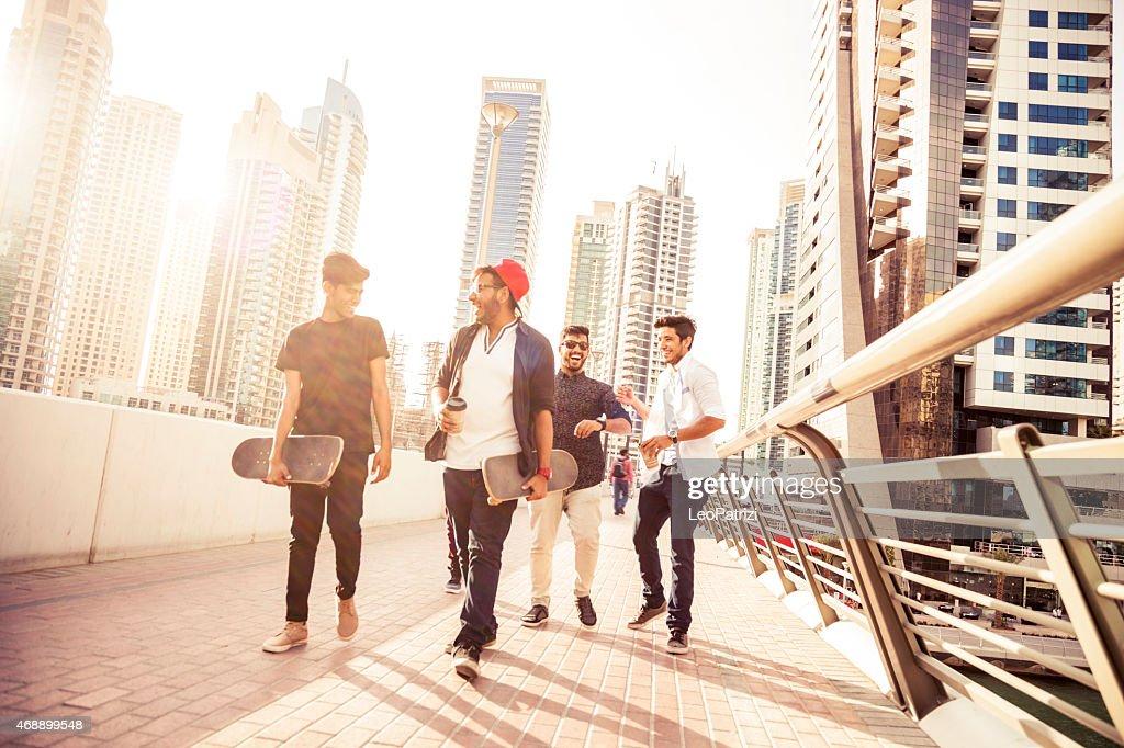 Friends enjoying Dubai city life : Stock Photo